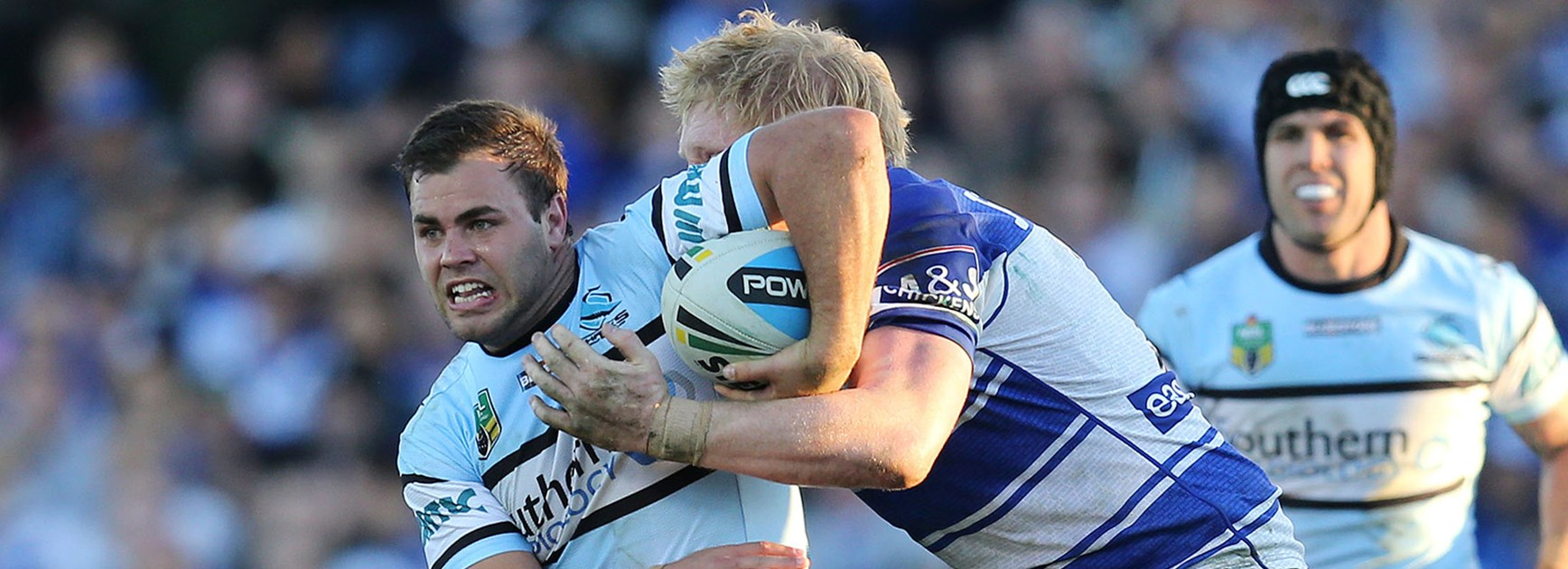 Cronulla's Wade Graham is tackled by Canterbury's James Graham in Round 20 at Belmore Sports Ground.