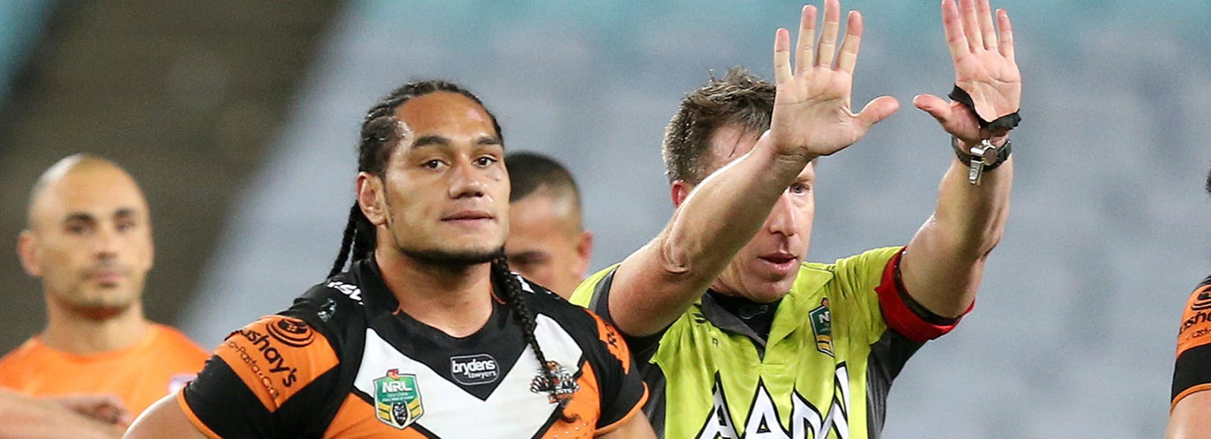 Wests Tigers forward Martin Taupau copped 10 minutes in the sin-bin for a swinging arm on Roosters five-eighth James Maloney.