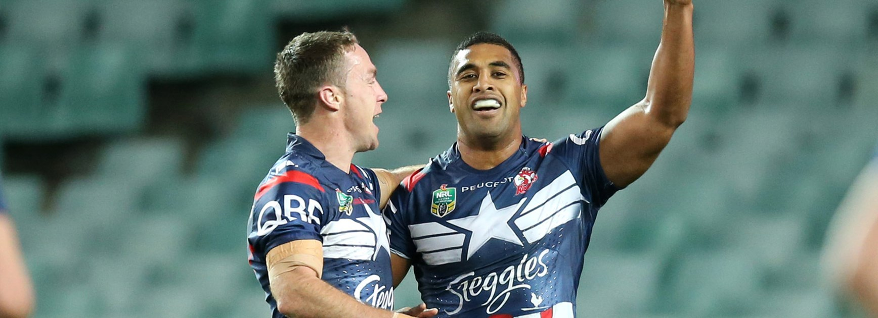 Michael Jennings and James Maloney in the Roosters' win over the Dogs.