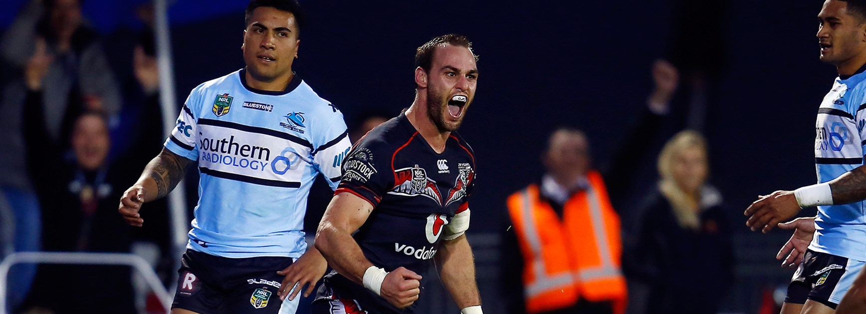 Simon Mannering celebrates his first try of the season against the Sharks.