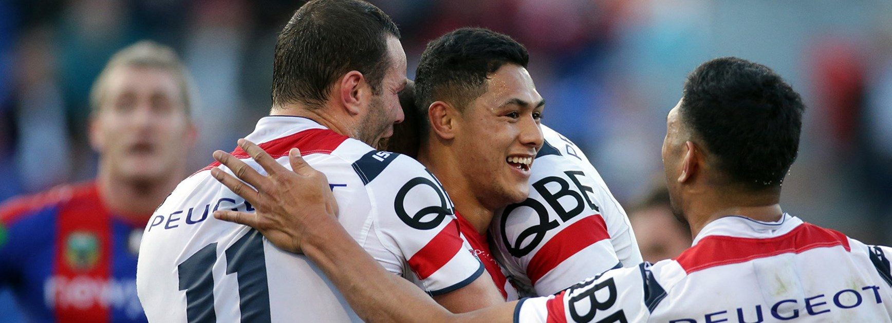 Roosters players celebrate another Roger Tuivasa-Sheck try against Newcastle.