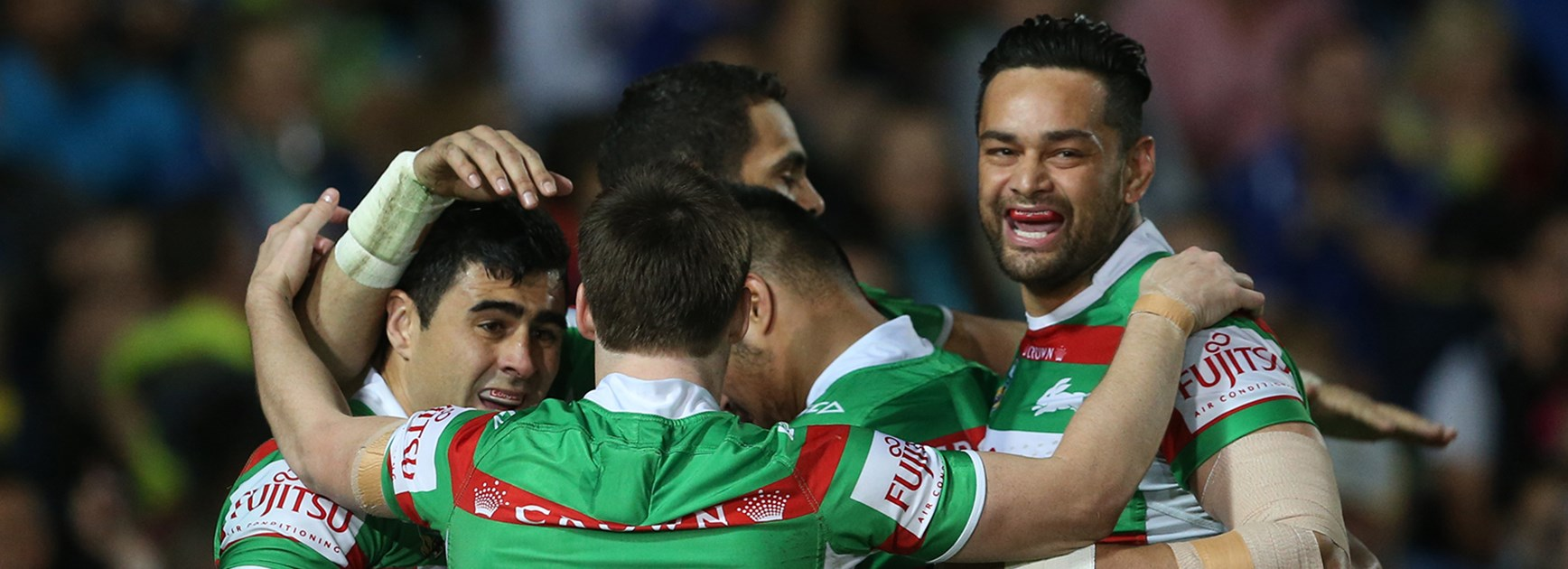 South Sydney celebrate the opening try of the game by Greg Inglis.