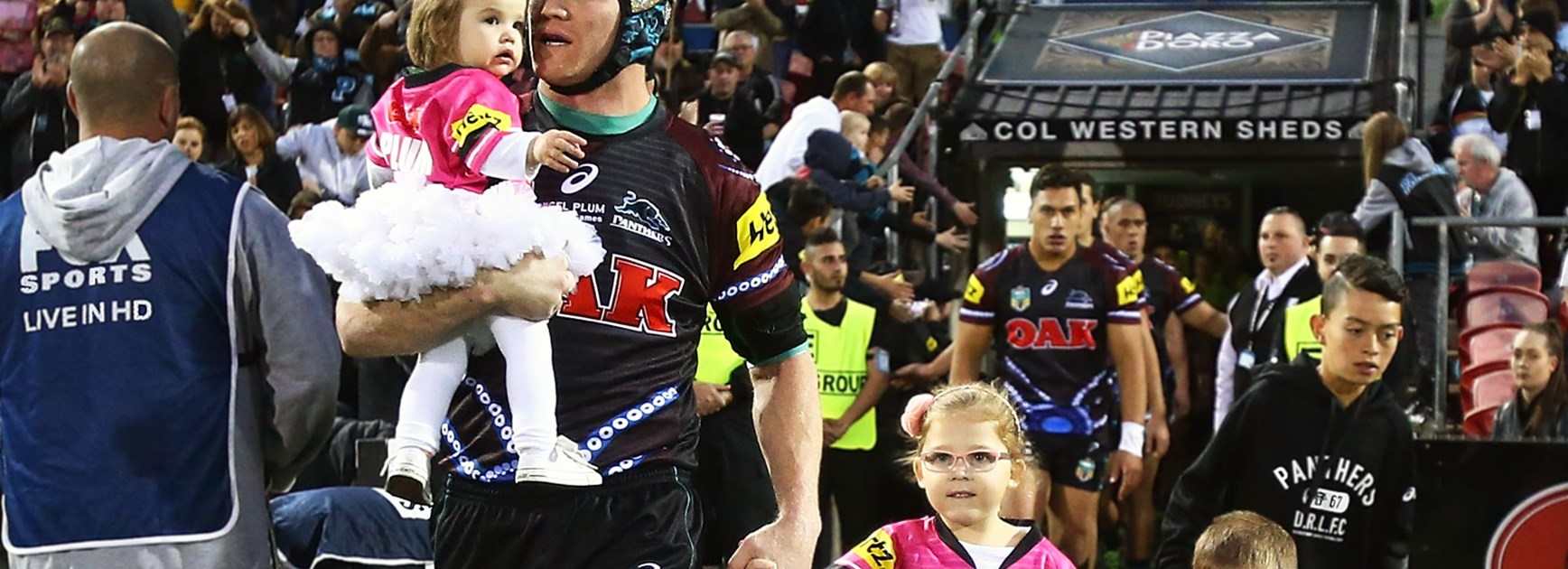 Nigel Plum and his children lead the Panthers onto the ground ahead of his final game in the NRL.