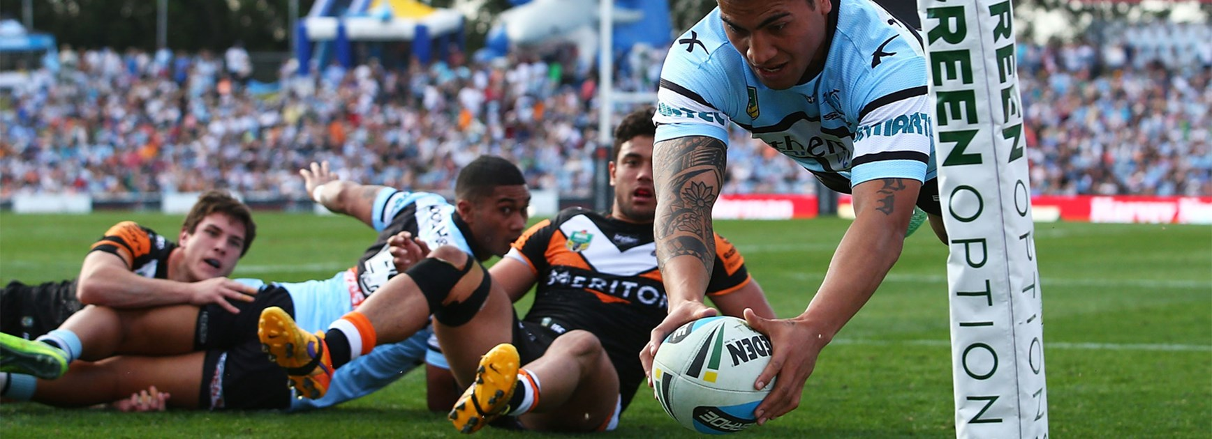 Sosaia Feki dives over to score the first of his try tries againt the Wests Tigers on Saturday.