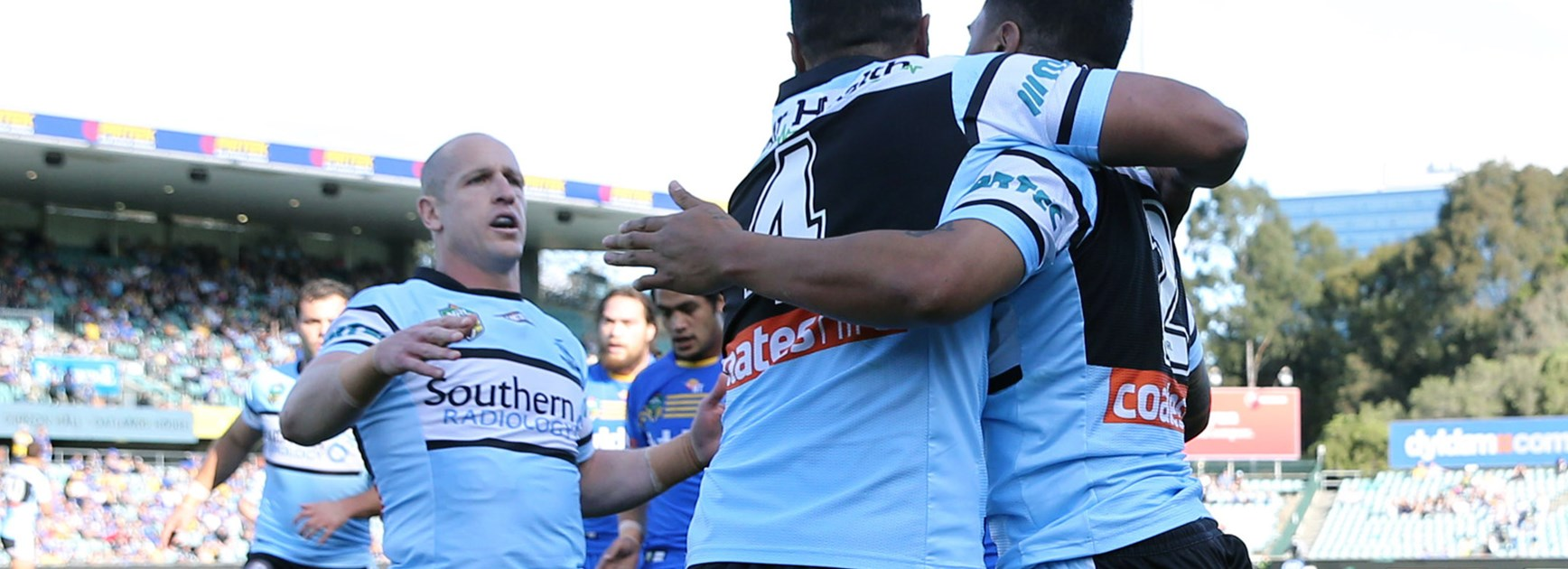 The Sharks celebrate Sosaia Feki's first-half try.