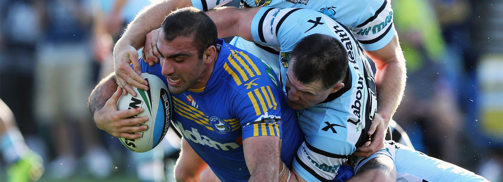 Tim Mannah is brought down by the Cronulla defence.