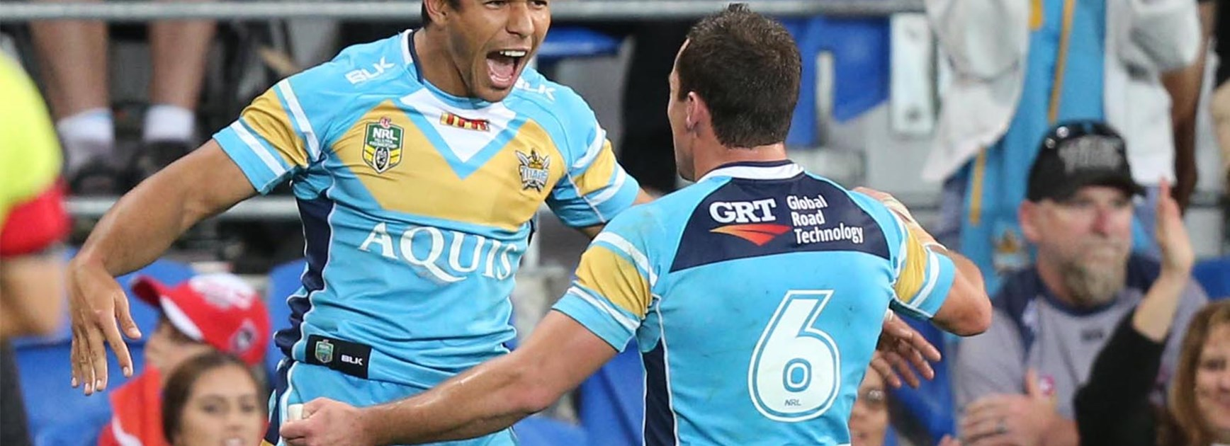 David Mead celebrates his try to put the Titans in front of the Dragons.