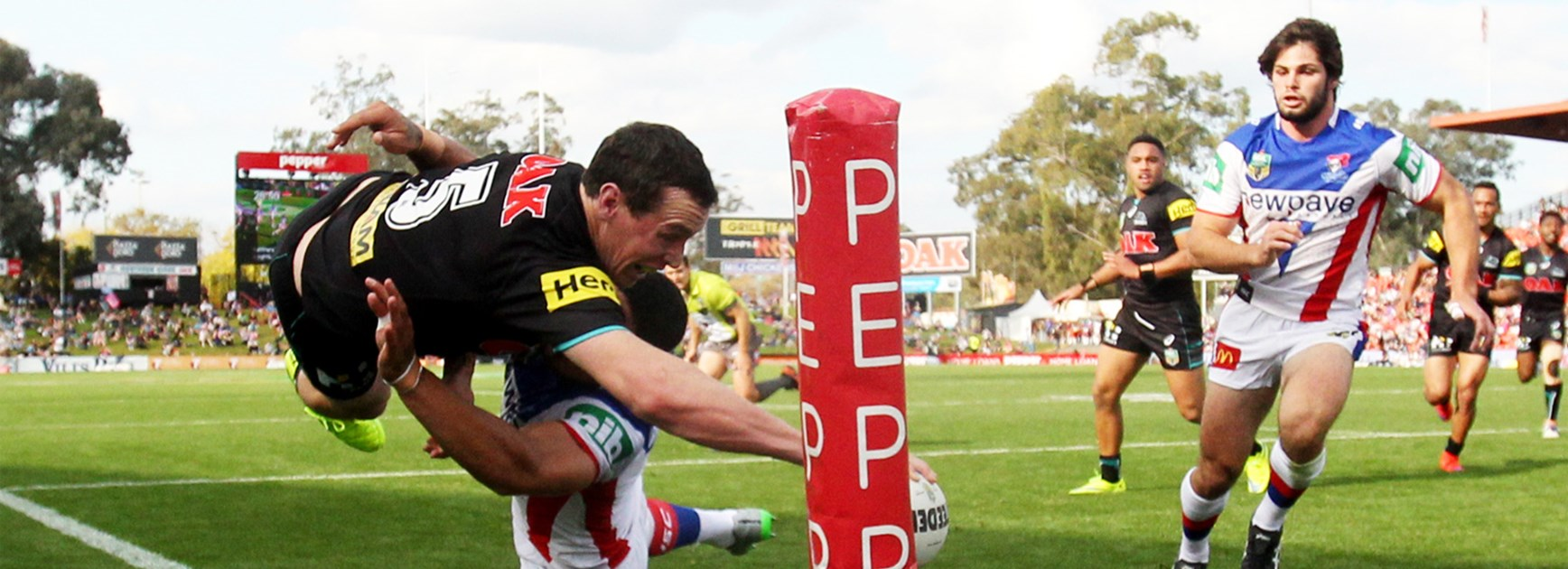 Retiring Panthers winger David Simmons leaps towards the corner in his final NRL game against Newcastle.
