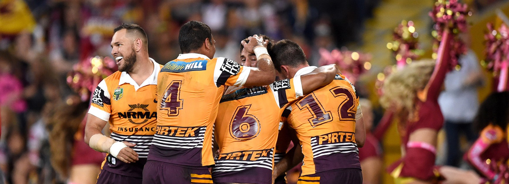 The Broncos celebrate their qualifying final win over the Cowboys at Suncorp Stadium.