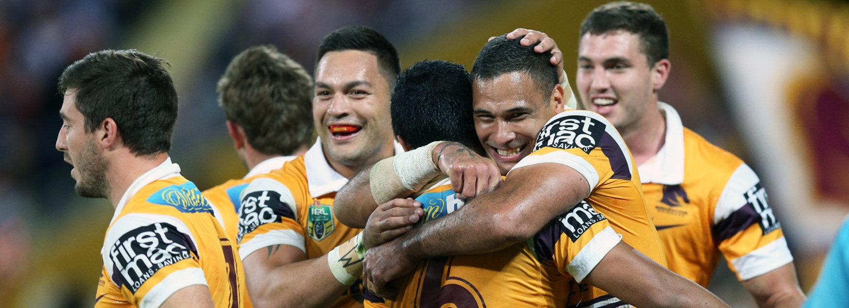 Broncos players celebrate during their preliminary final win over the Roosters.