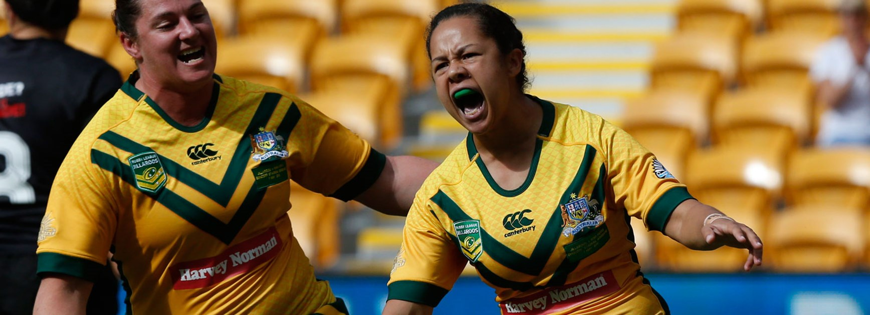 Jenny-Sue Hoepper celebrates her try in the Jillaroos' clash with the Kiwi Ferns.