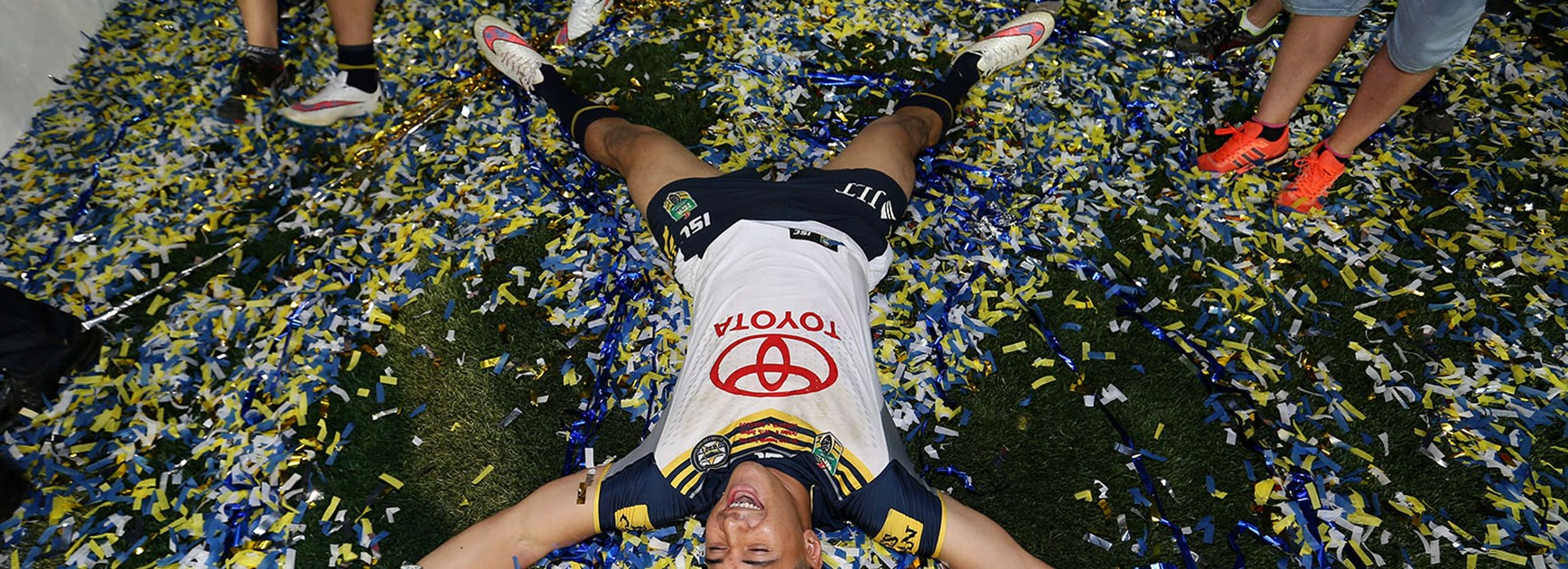 Jason Taumalolo makes a confetti angel after the Cowboys win the 2015 Telstra Premiership grand final.