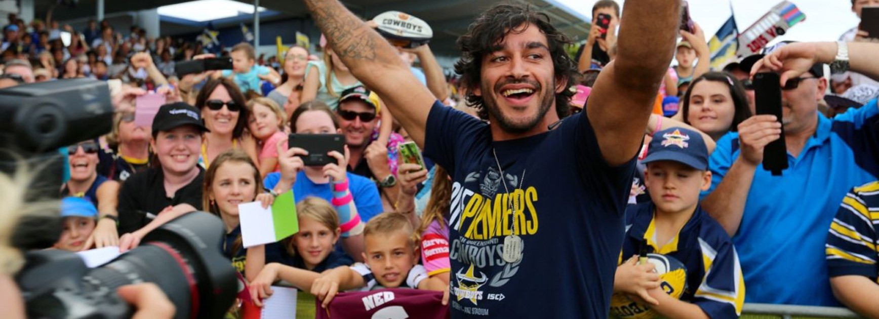 Johnathan Thurston with fans during the Cowboys' premiership trophy tour of North Queensland.