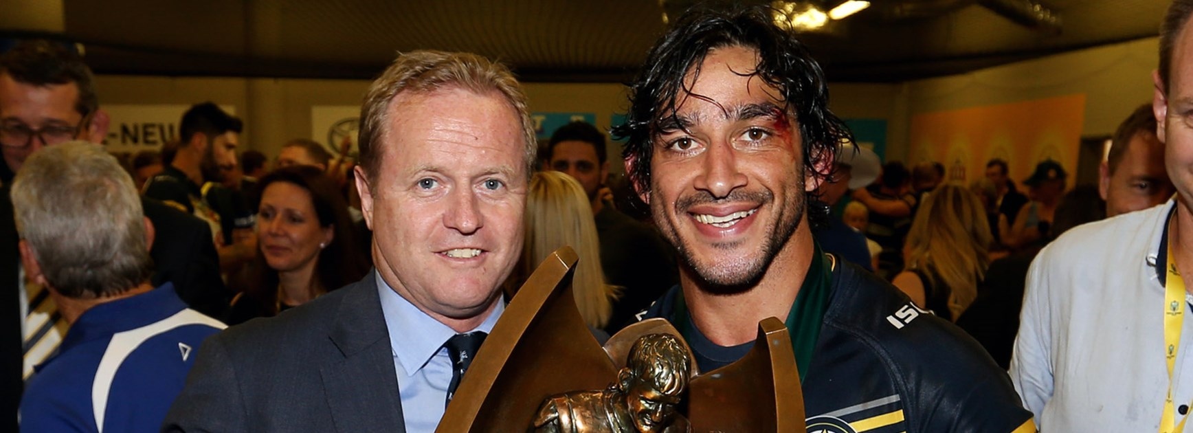 Departing NRL CEO Dave Smith with victorious Cowboys co-captain Johnathan Thurston following the 2015 Grand Final.