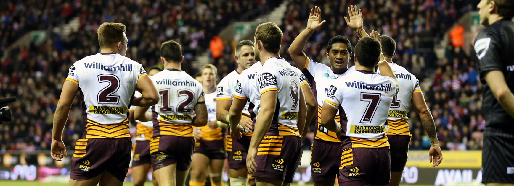 Broncos players celebrate during their big World Club Series win over Wigan.
