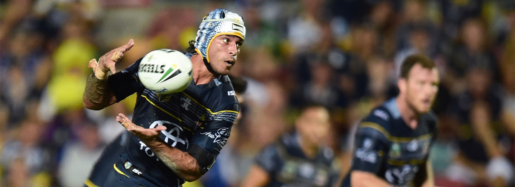 Johnathan Thurston takes a pass during the Cowboys' Round 1 clash with Cronulla.