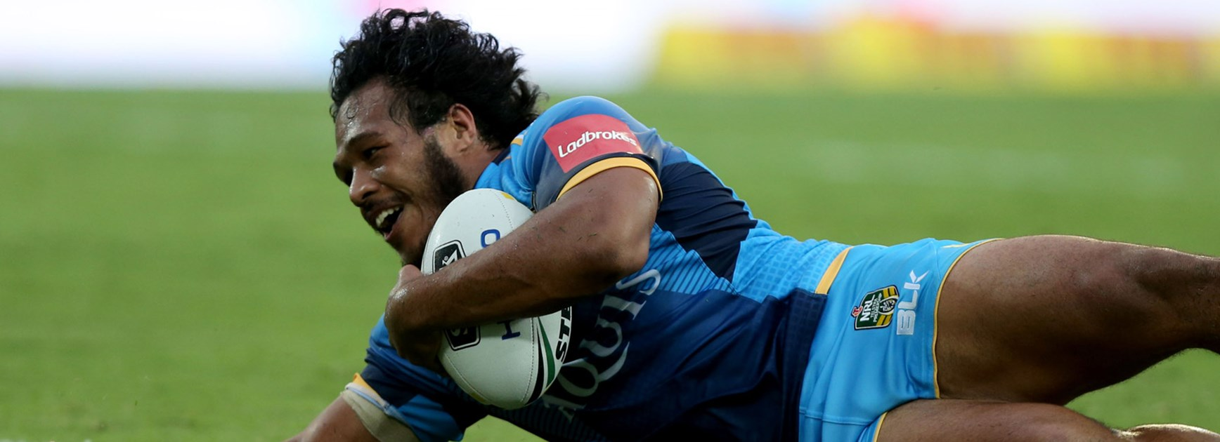Agnatius Paasi crossing for a try and loving life as the Titans accounted for the Knights in Round 1.