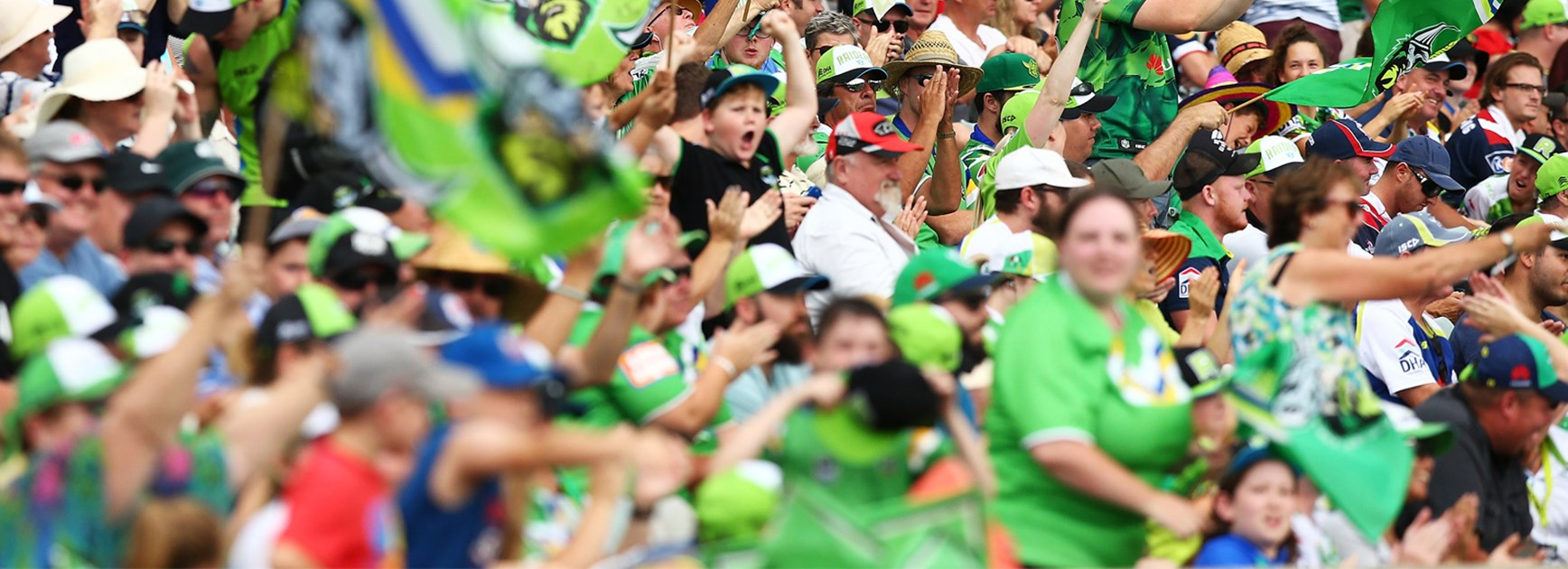 Canberra Raiders fans celebrate their team's win over the Roosters in Round 2.