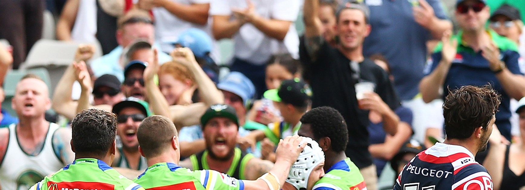 The Raiders celebrate Jarrod Croker's late try against the Roosters on Saturday.