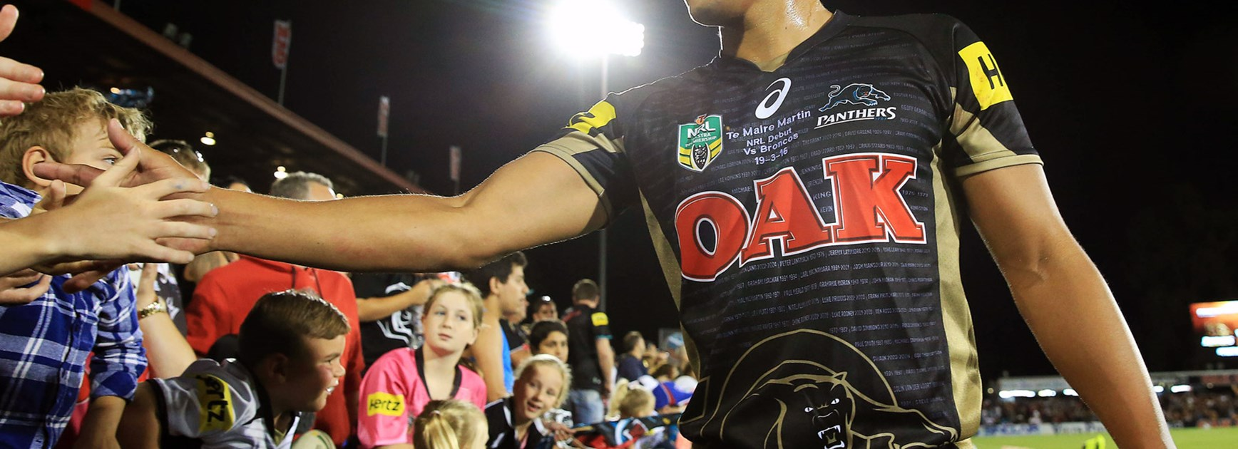 Te Maire Martin with Panthers fans following his NRL debut heroics.