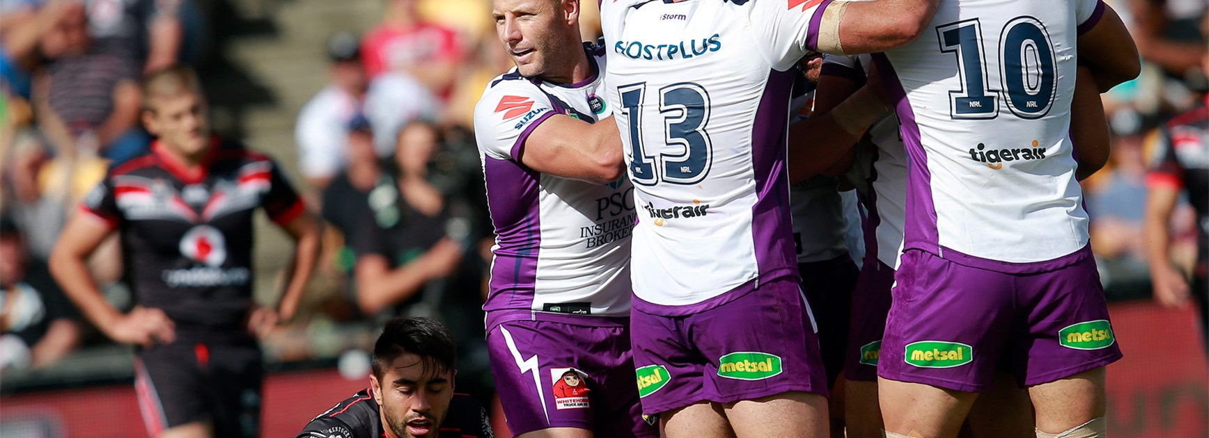 The Melbourne Storm celebrate an early try against the Warriors on Sunday.