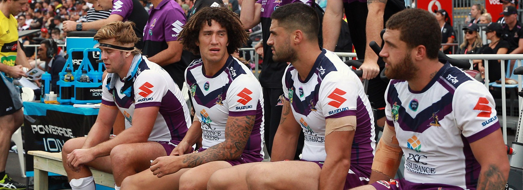 The Storm bench look on during their tight win over the Warriors in Round 3.