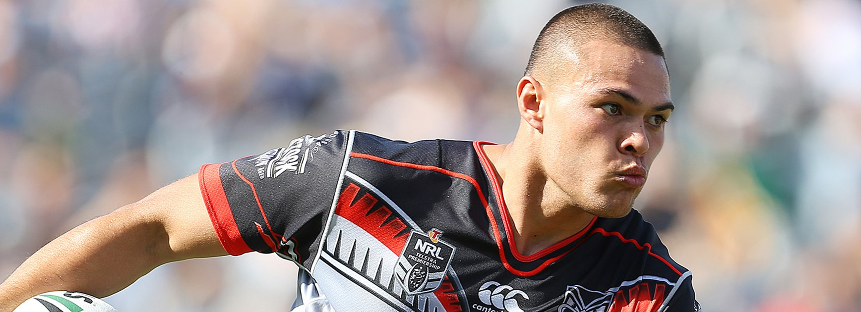 Tui Lolohea in action against the Roosters in Round 5.