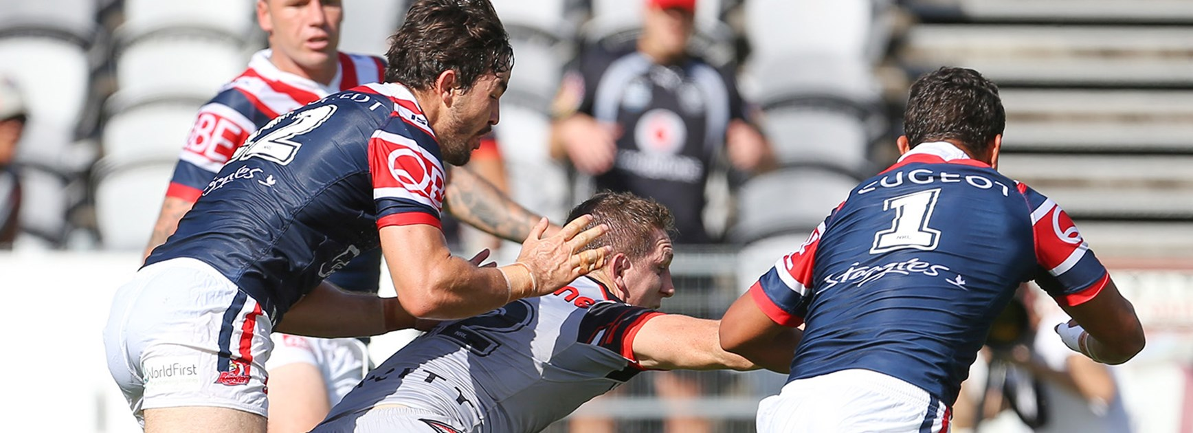 Ryan Hoffman is held back by the Roosters defence while trying to score a try in Round 5.