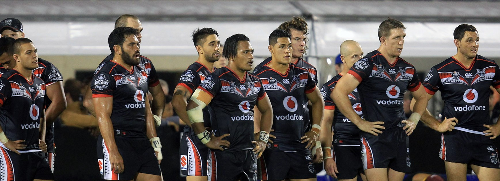 Warriors players look on dejected following their loss to the Sea Eagles.