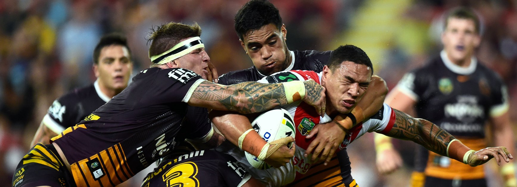 Broncos players tackle Tyson Frizell.