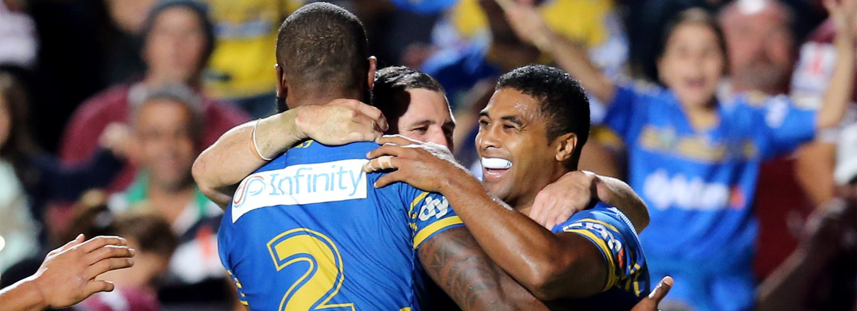 The Eels celebrate Michael Jennings' second try in his 200th NRL game.