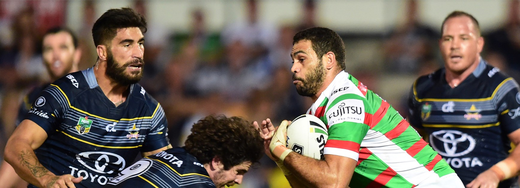 Greg Inglis meets the Cowboys defence in Round 7.