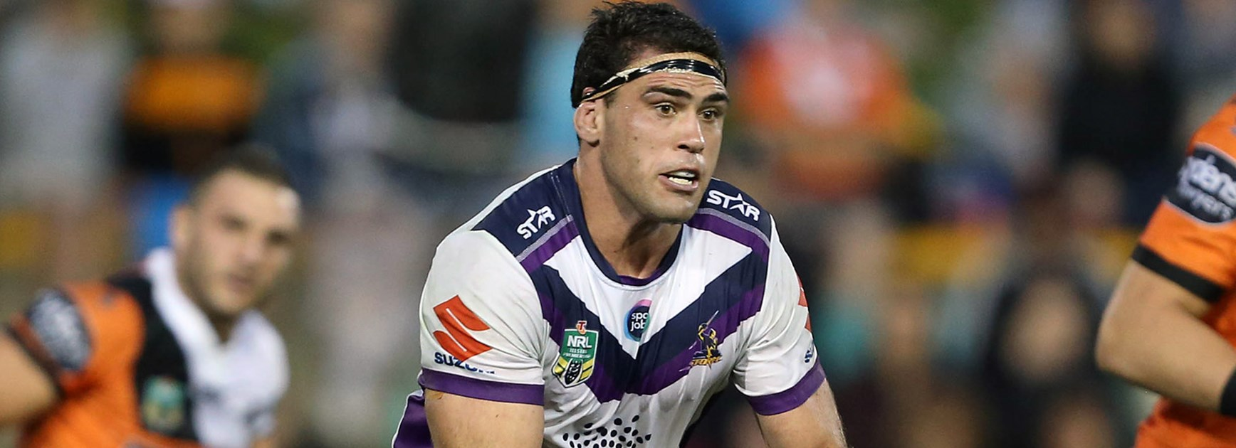 Storm lock Dale Finucane against Wests Tigers.
