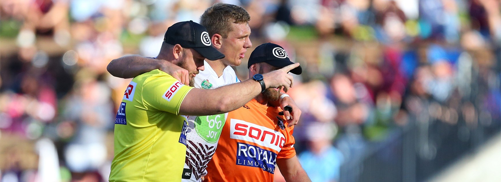 Tom Trbojevic is helped from the field during Manly's win over the Knights on Anzac Day.