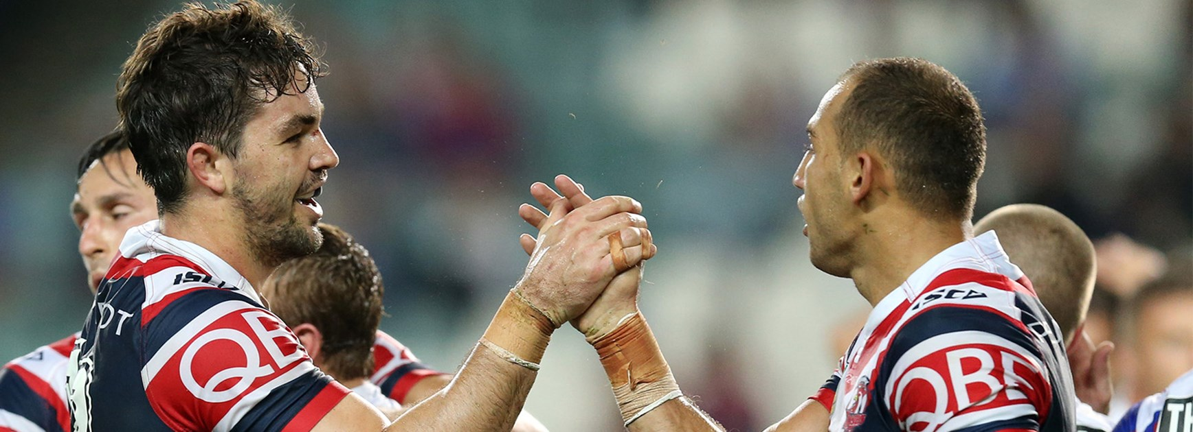 The Roosters celebrate Blake Ferguson's try against the Knights in Round 9.