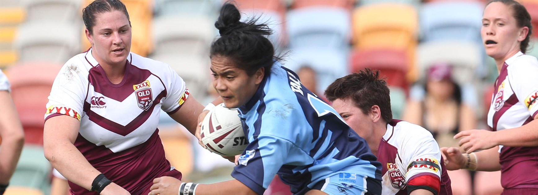 Simaima Tau takes a charge for the women's NSW team against Queensland on Saturday.