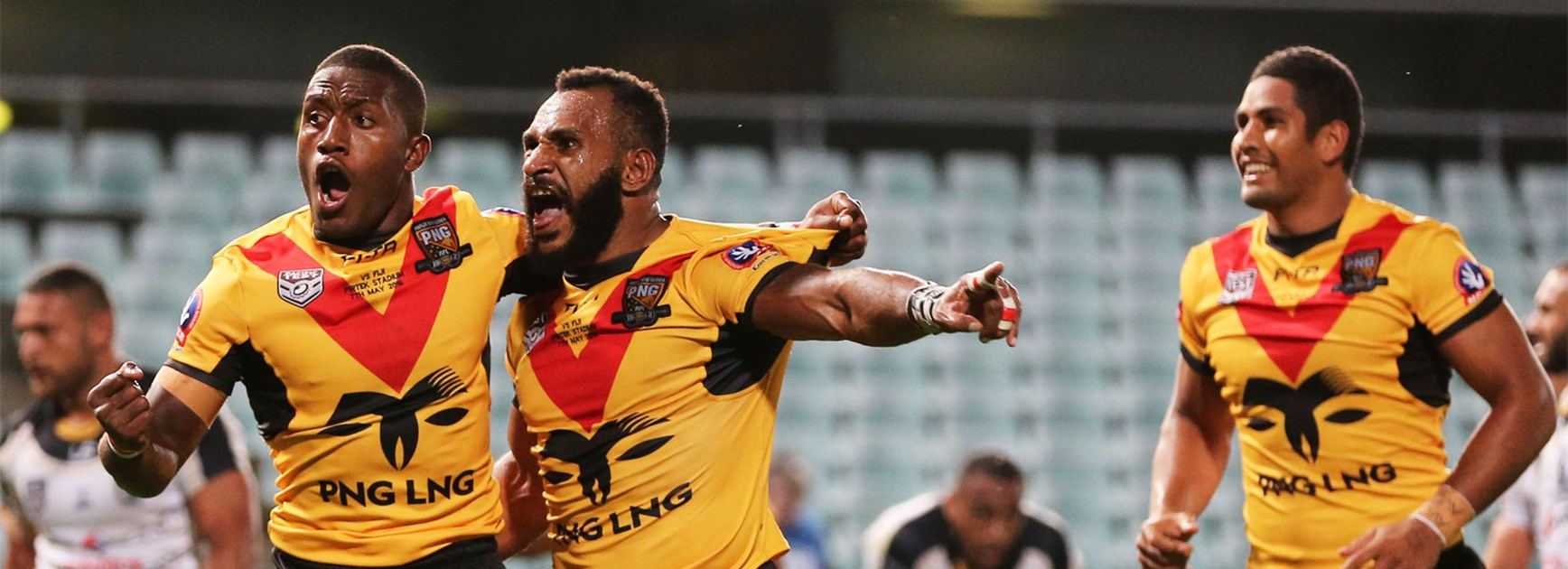 Papua New Guinea celebrate a try during their win over Fiji on Saturday night.