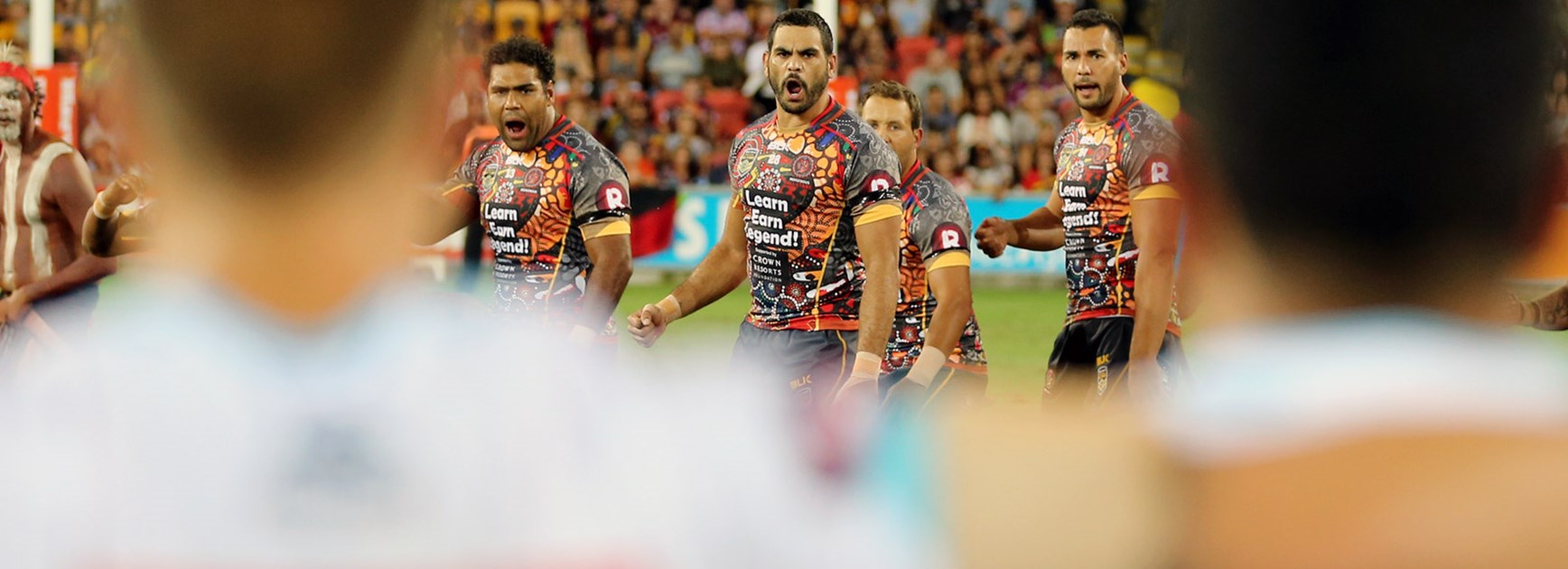 Greg Inglis leads the Indigenous All Stars during their pre-match war cry in the 2016 NRL All Stars match.