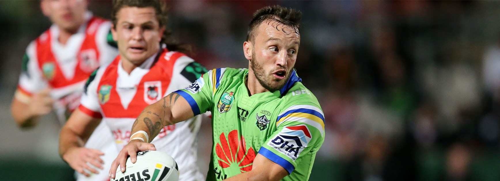Josh Hodgson shapes to pass during Canberra's Round 10 clash with the Dragons.