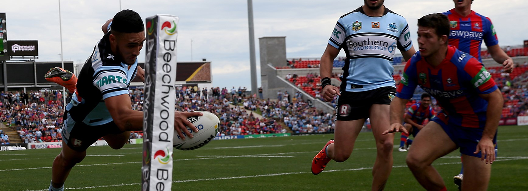Valentine Holmes scored a hat-trick in the first half against Newcastle.