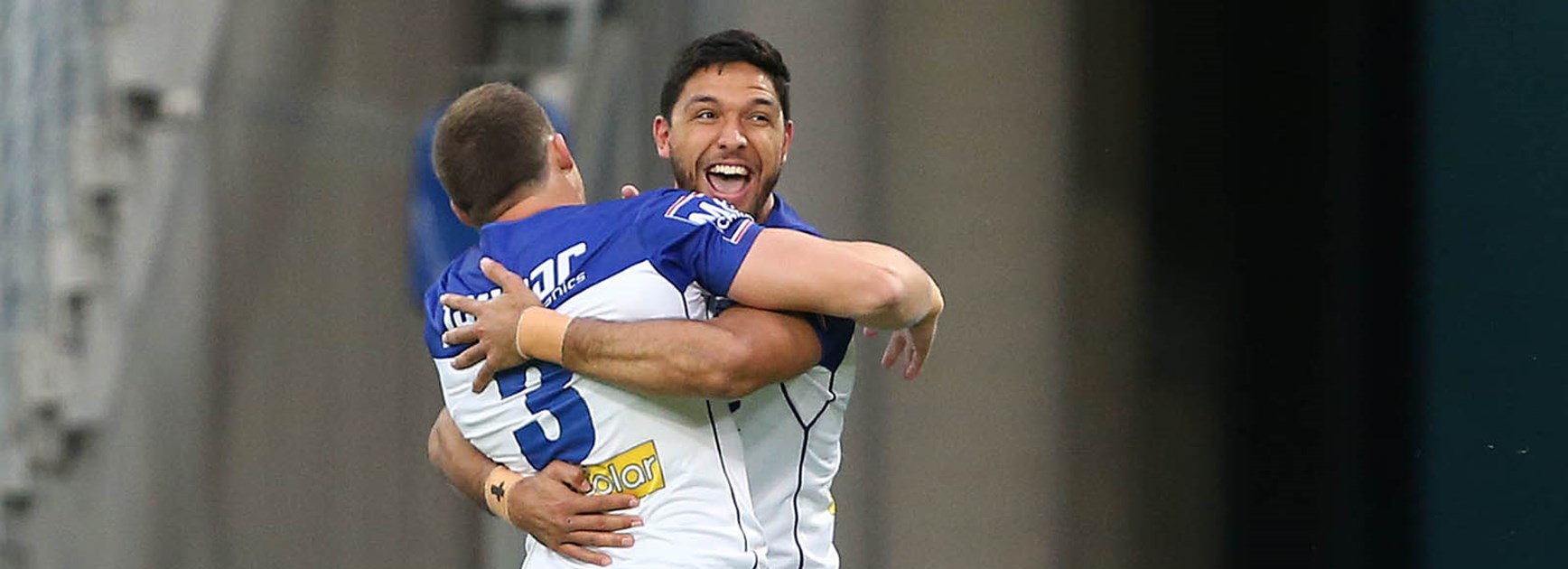 Bulldogs celebrate a try against the Wests Tigers at ANZ Stadium in Round 10.