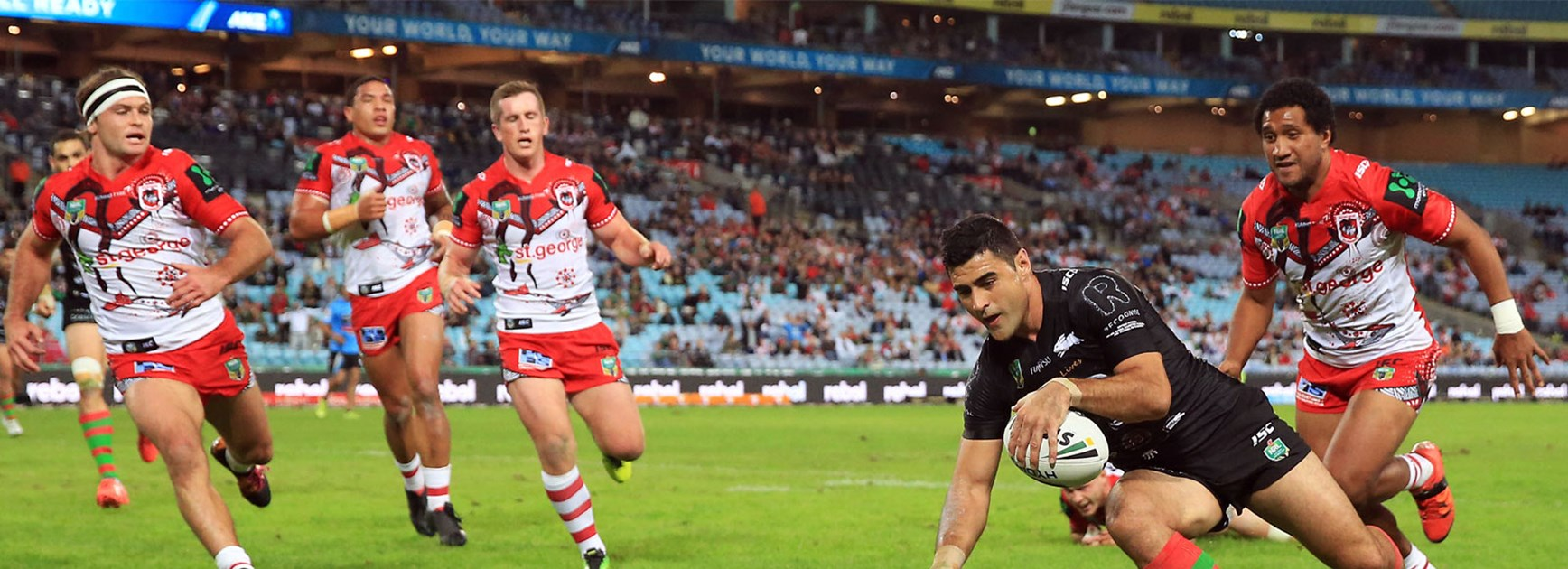 Bryson Goodwin crosses for the Rabbitohs against the Dragons on Thursday night.