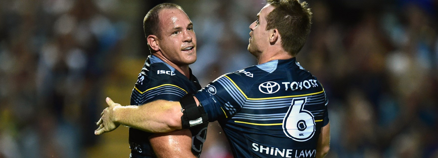 Cowboys Matt Scott and Michael Morgan celebrate against the Broncos in Round 11.