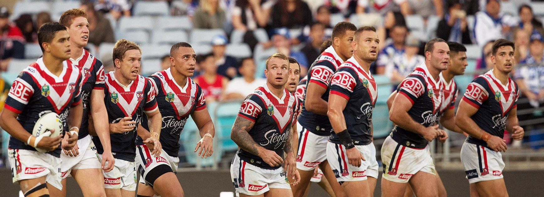 Roosters players look on in their loss to the Bulldogs in Round 11.