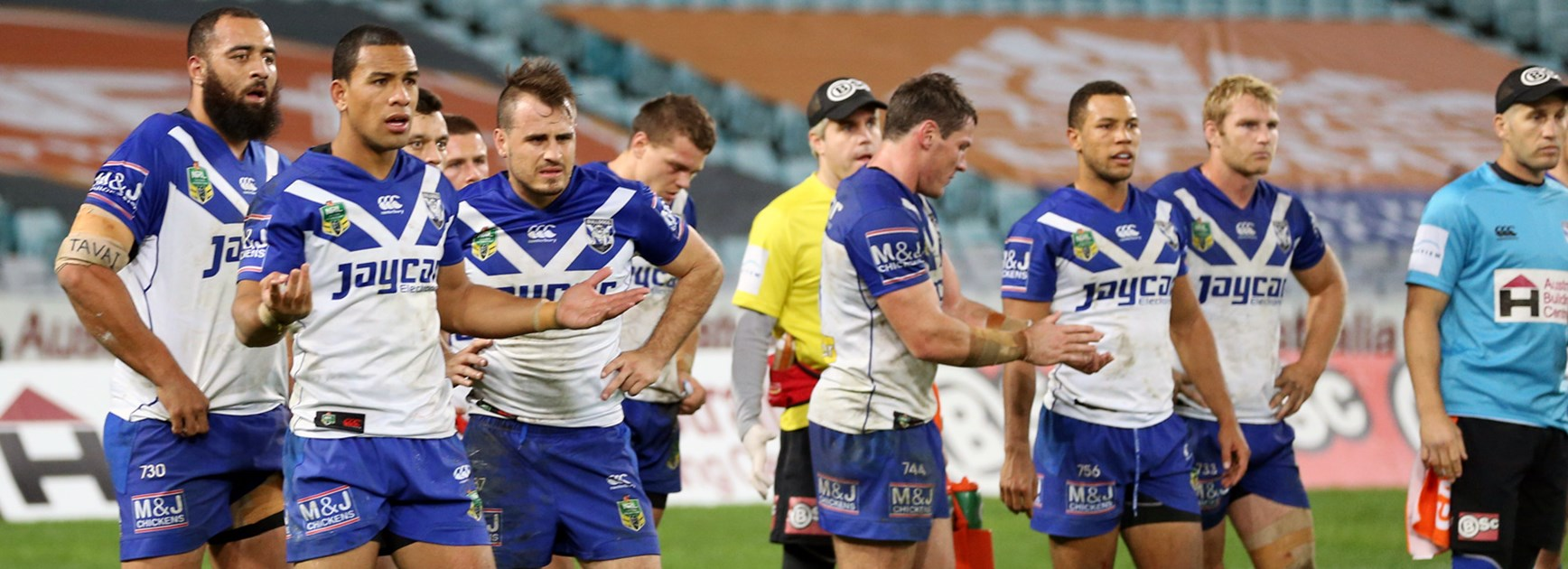 Bulldogs players look on dejected during their Round 13 loss to the Sharks.