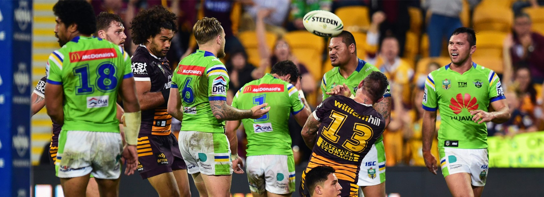 Raiders players look on as Corey Parker celebrates scoring the Broncos' opening try on Thursday night.