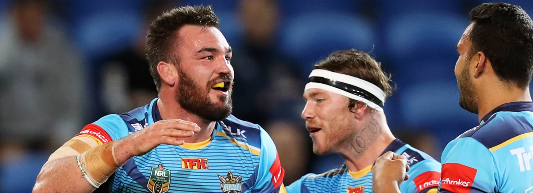 Titans front-rower Luke Douglas celebrates his try against Manly.