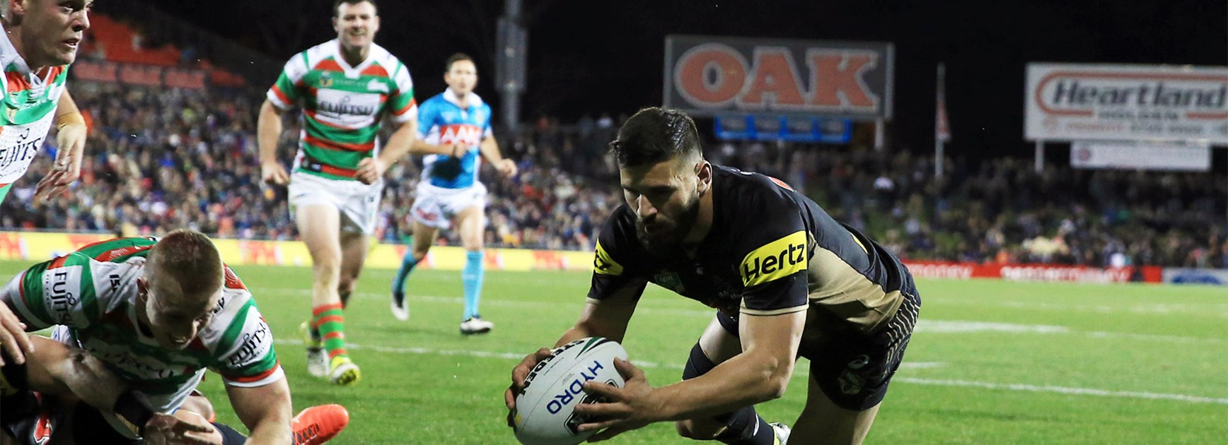 Josh Mansour scores for the Panthers against Souths on Friday night.