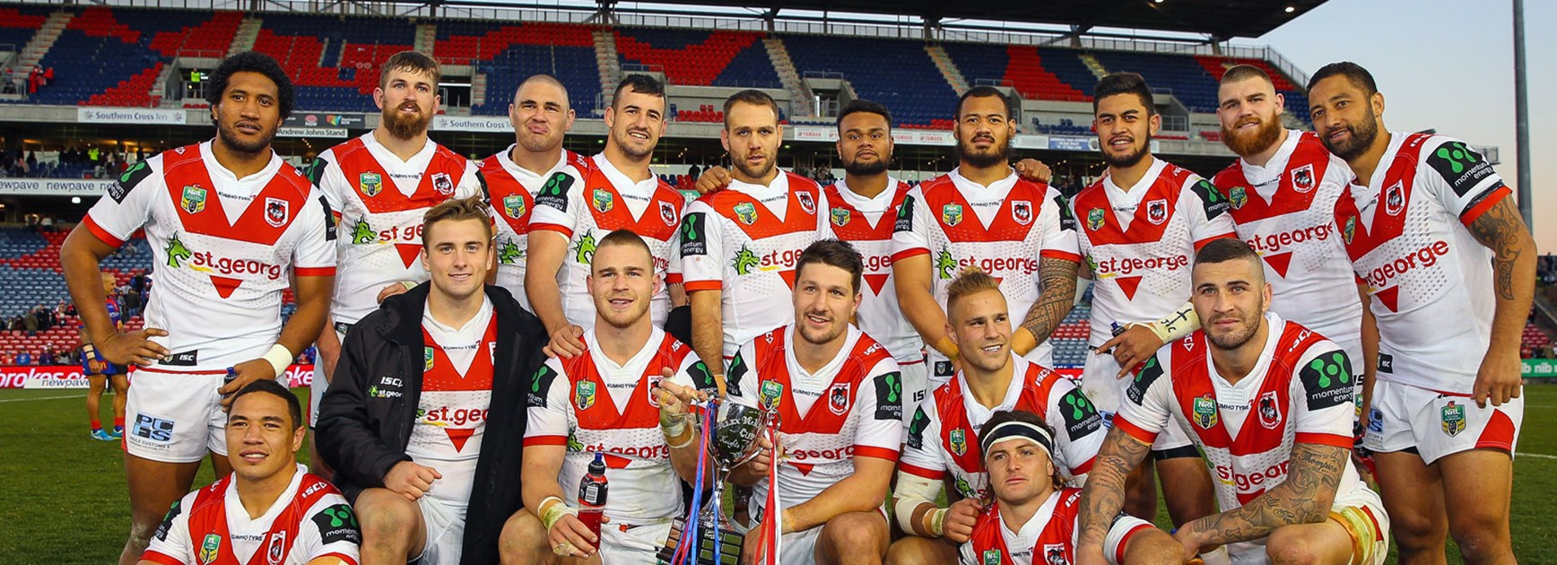 Dragons players with the Alex McKinnon Cup following their win over the Knights.