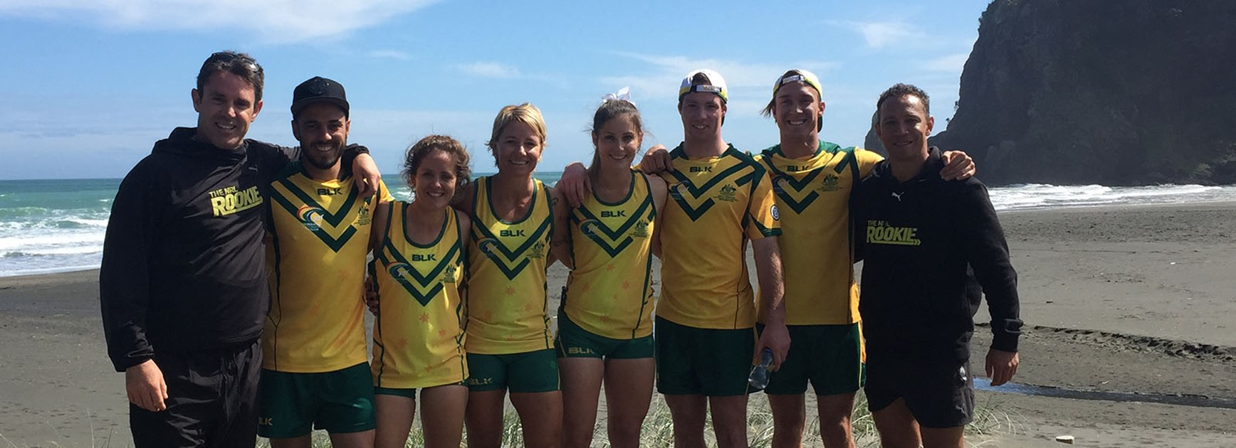 Members of the Australian touch football team with Brad Fittler.
